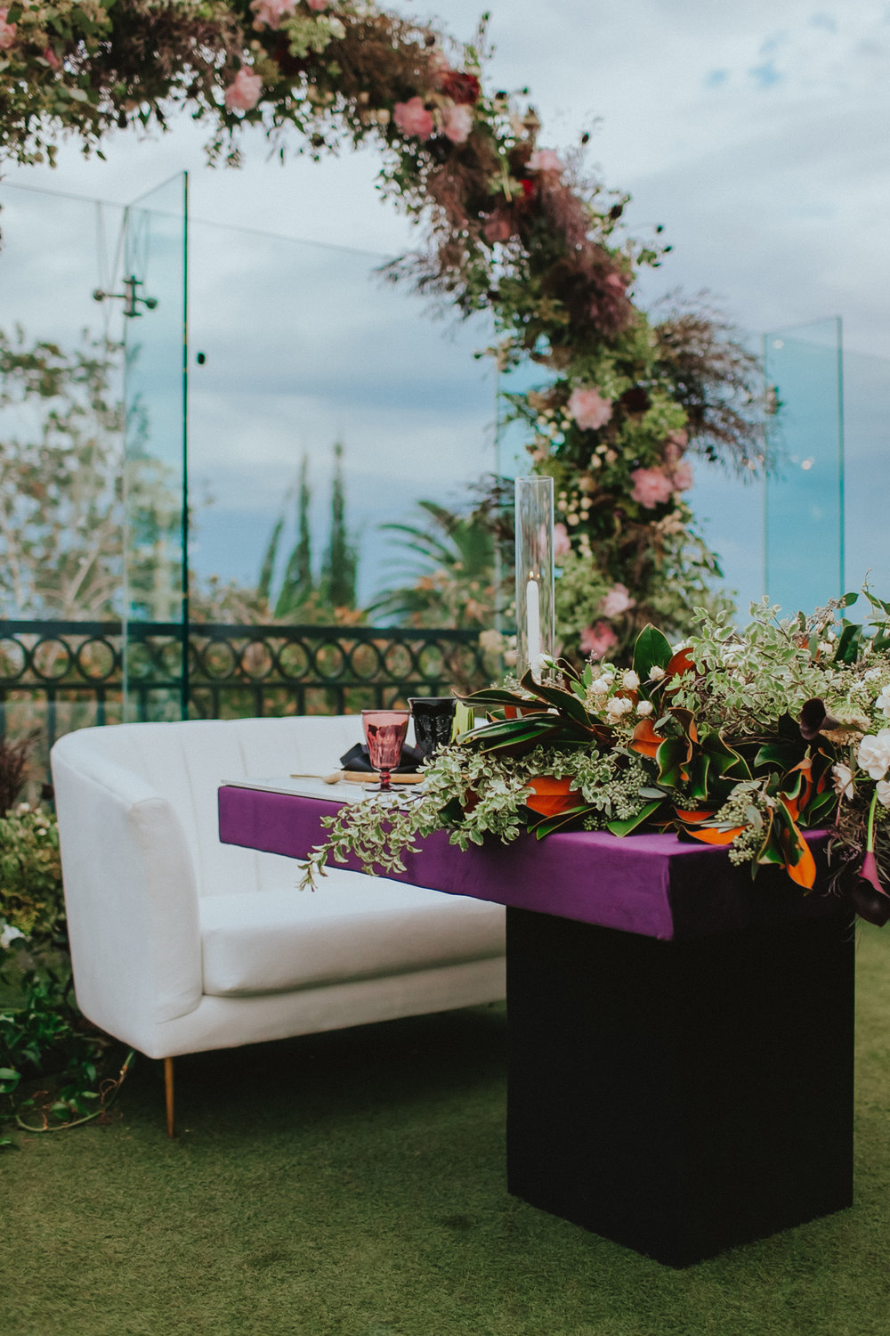 Breathtaking Contemporary Jewel Toned Fall Posh Wedding sweatheart table under floral arch.jpg