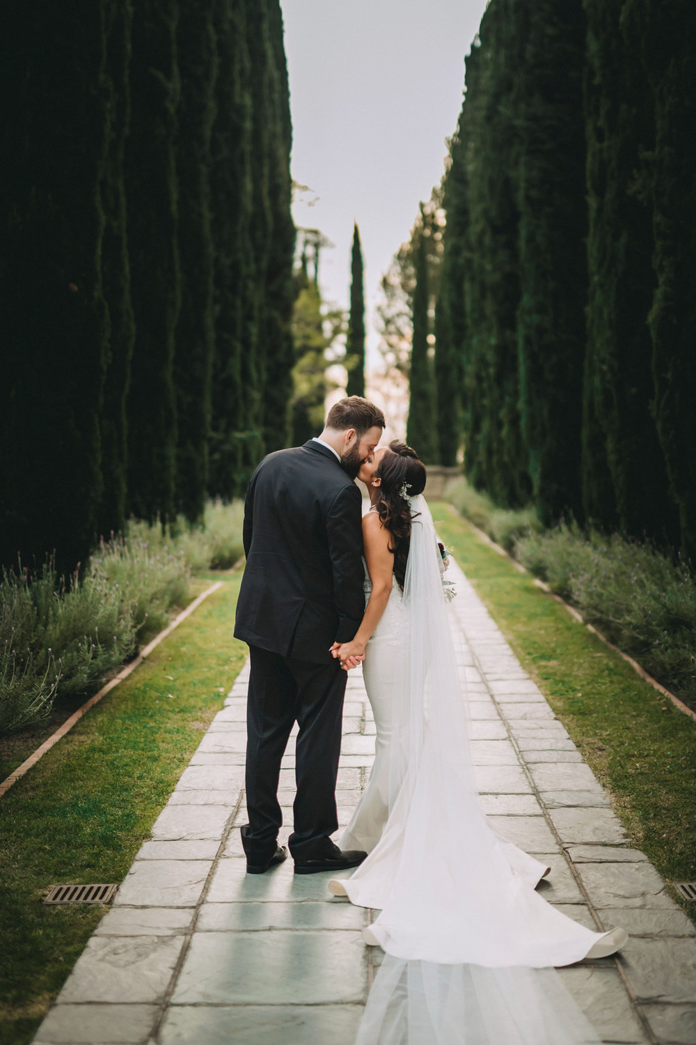 Breathtaking Contemporary Jewel Toned Fall Posh Wedding bride and groom in the gardens.jpg
