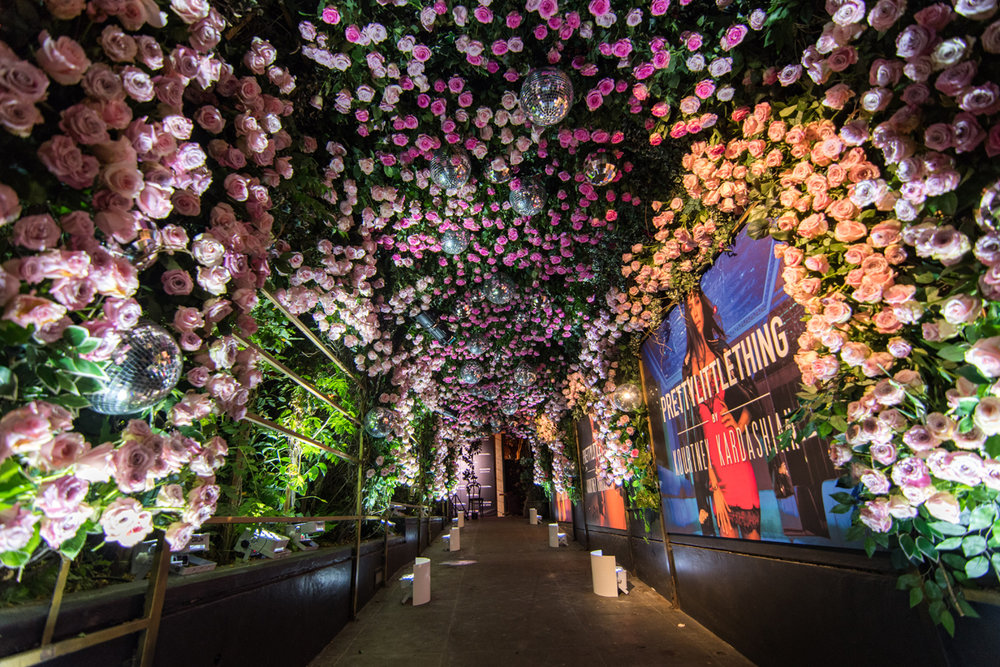 PrettyLittleThing PLT X Kourtney Kardashian Collection Celebrity Launch Party entrance full of flowers.jpg
