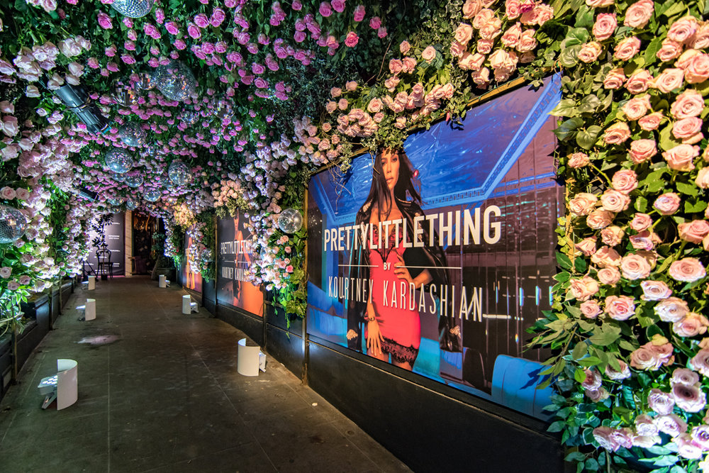 PrettyLittleThing PLT X Kourtney Kardashian Collection Celebrity Launch Party KKs picture in the tunnel of flowers.jpg