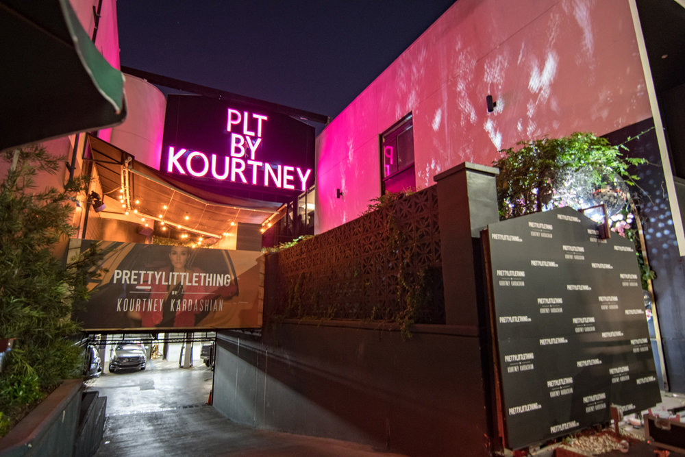 PrettyLittleThing PLT X Kourtney Kardashian Collection Celebrity Launch Party giant pink marquee letters.jpg