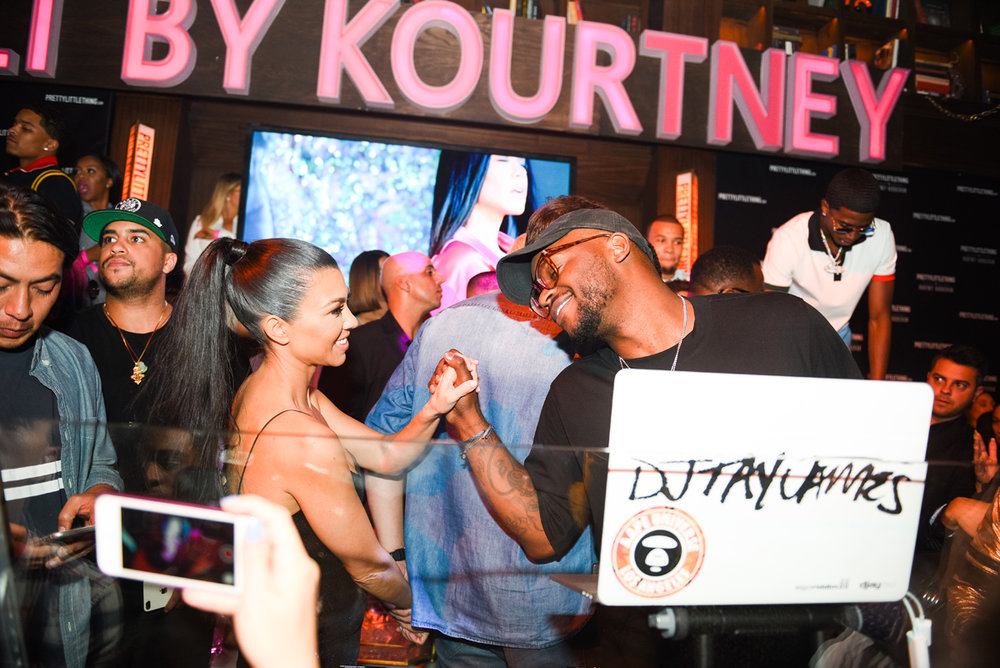 PrettyLittleThing PLT X Kourtney Kardashian Collection Celebrity Launch Party Kourtney at DJ booth.jpg