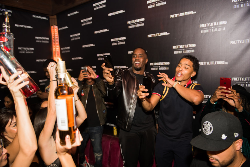 PrettyLittleThing PLT X Kourtney Kardashian Collection Celebrity Launch Party P Diddy having fun at the party.jpg