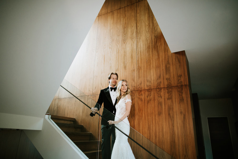Dreamy Starry Nights Wedding bride and groom pose on the grand stairs.jpg
