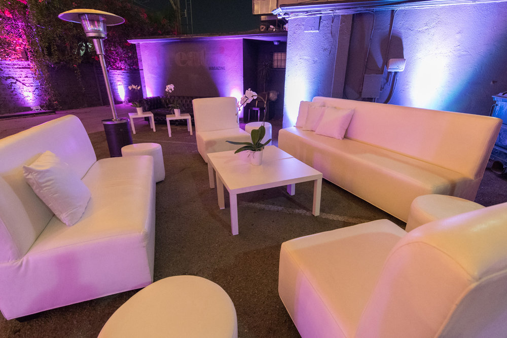 Rockin Out with Dave Rocco LA Birthday Party seating area with white leather furniture.jpg