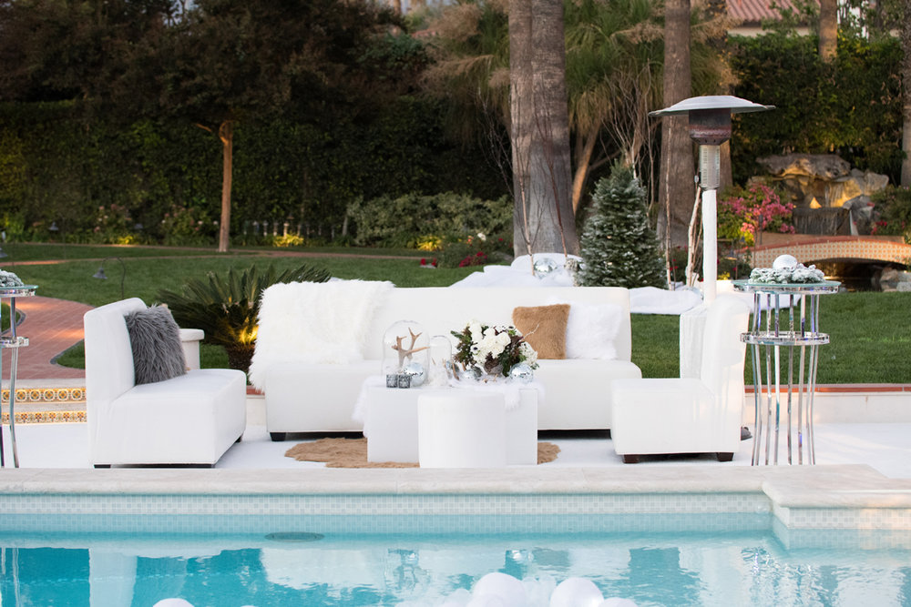 Narnia Inspired Opulent Winter Wonderland Party seating area next to pool.jpg