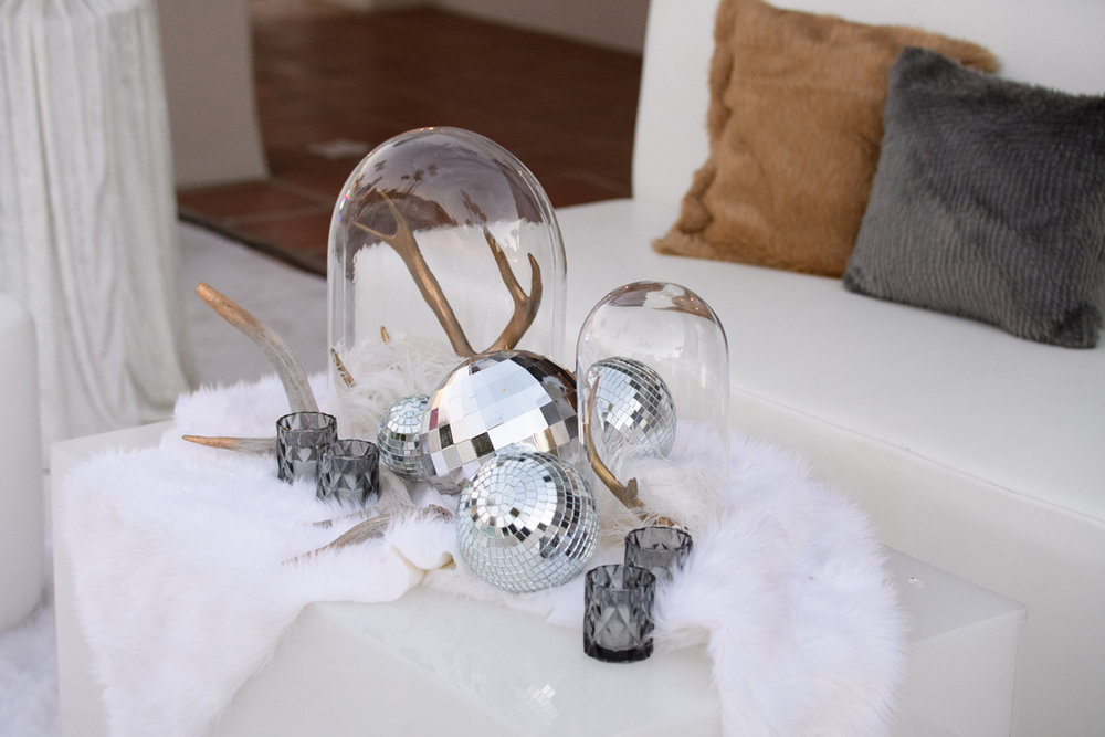 Narnia Inspired Opulent Winter Wonderland Party votives and gold deer horns centerpiece.jpg