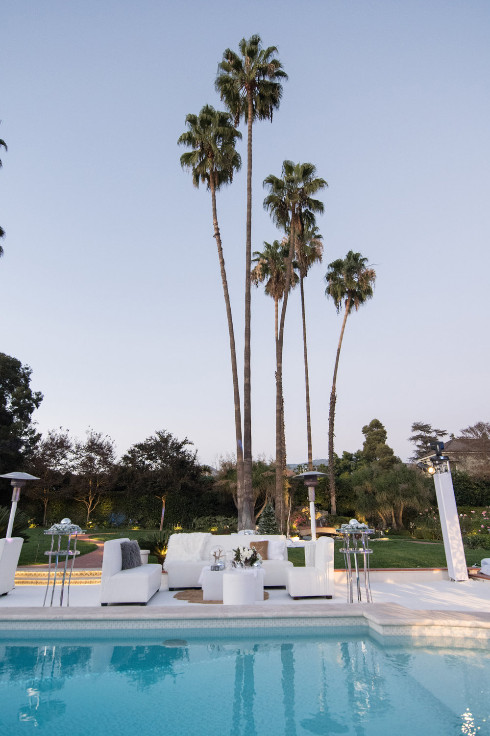 Narnia Inspired Opulent Winter Wonderland Party palm trees in california backyard.jpg