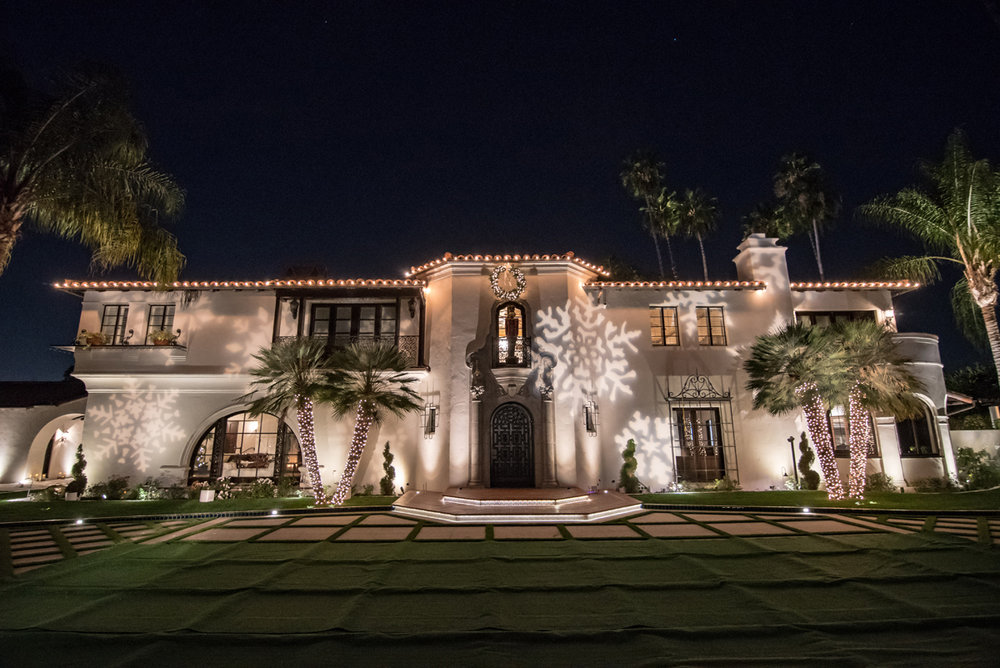 Narnia Inspired Opulent Winter Wonderland Party dancing snowflakes on house.jpg