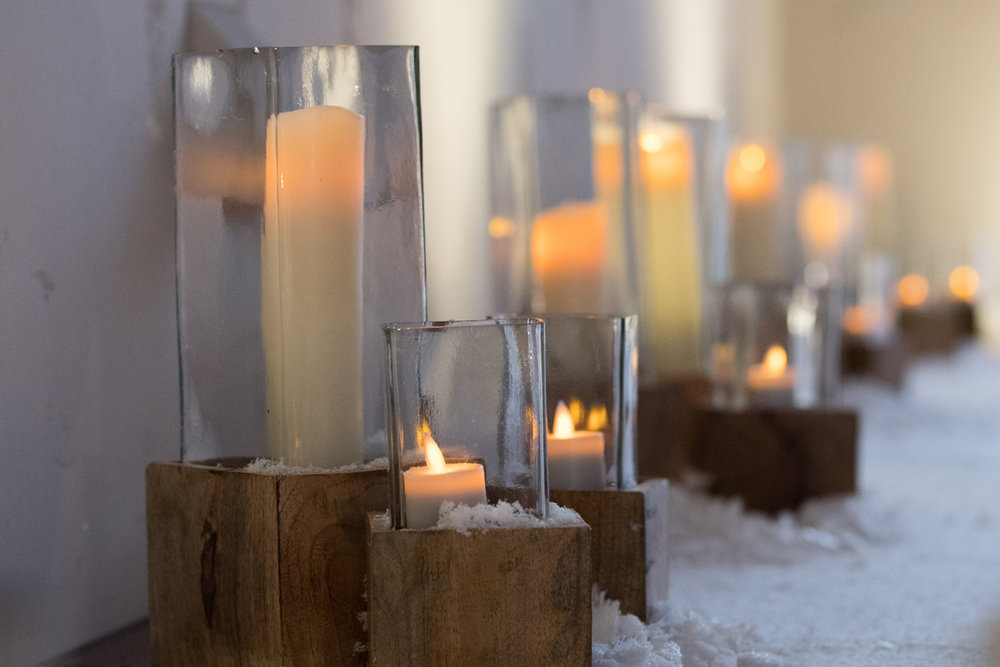 Narnia Inspired Opulent Winter Wonderland Party woodsy candles light the way.jpg