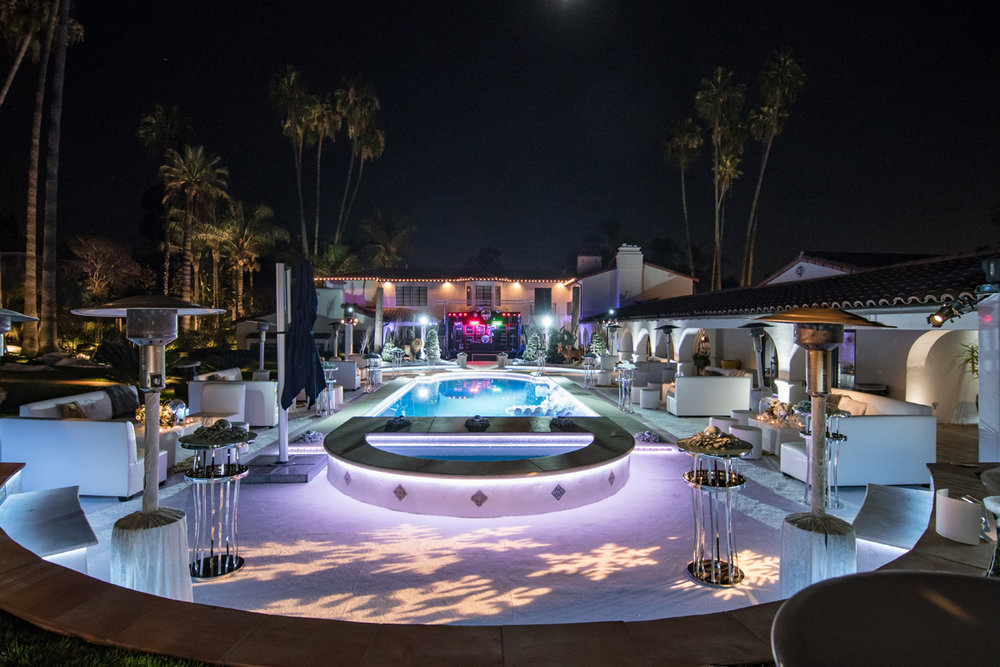 Narnia Inspired Opulent Winter Wonderland Party backyard with seating areas and stage at the end of the pool.jpg