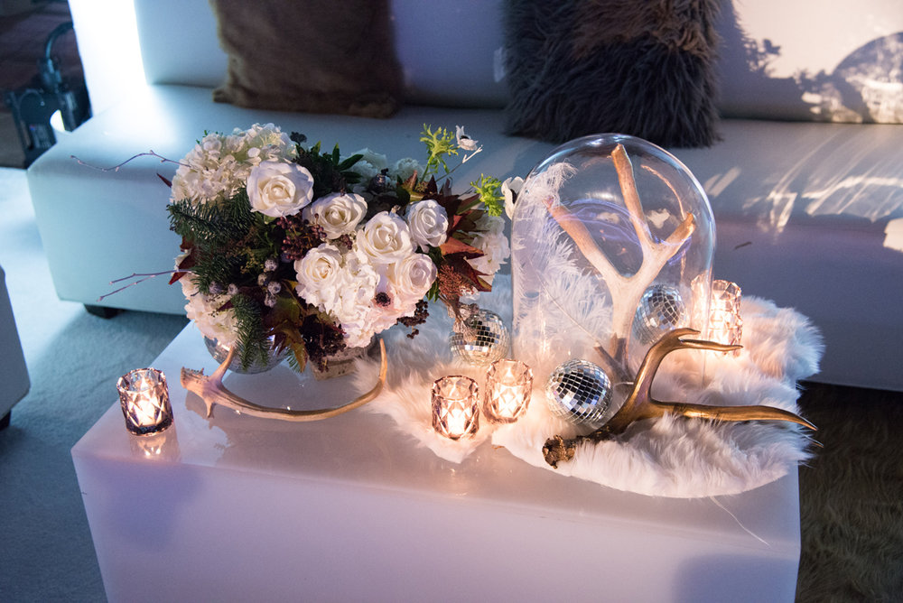 Narnia Inspired Opulent Winter Wonderland Party florals and antlers centerpiece.jpg