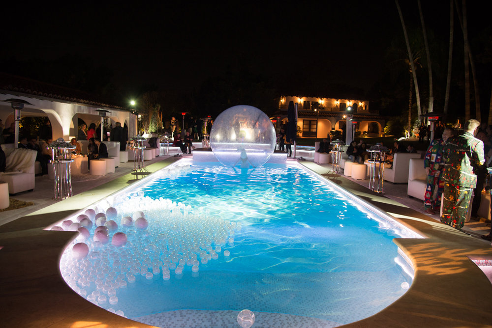 Narnia Inspired Opulent Winter Wonderland Party performer in bubble in the pool.jpg