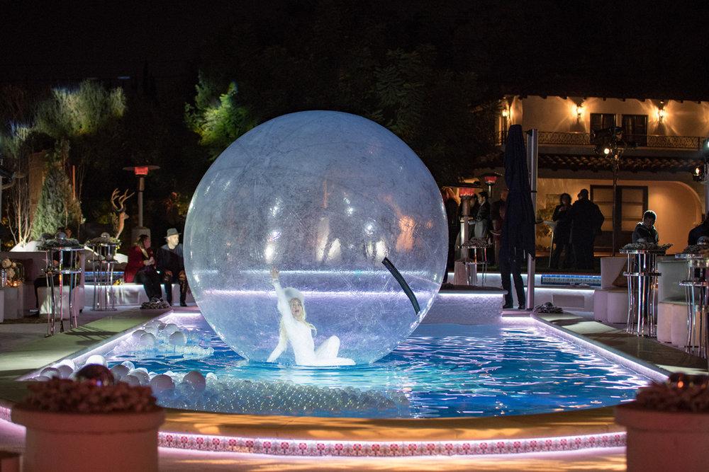 Narnia Inspired Opulent Winter Wonderland Party snowflake performer in pool bubble.jpg