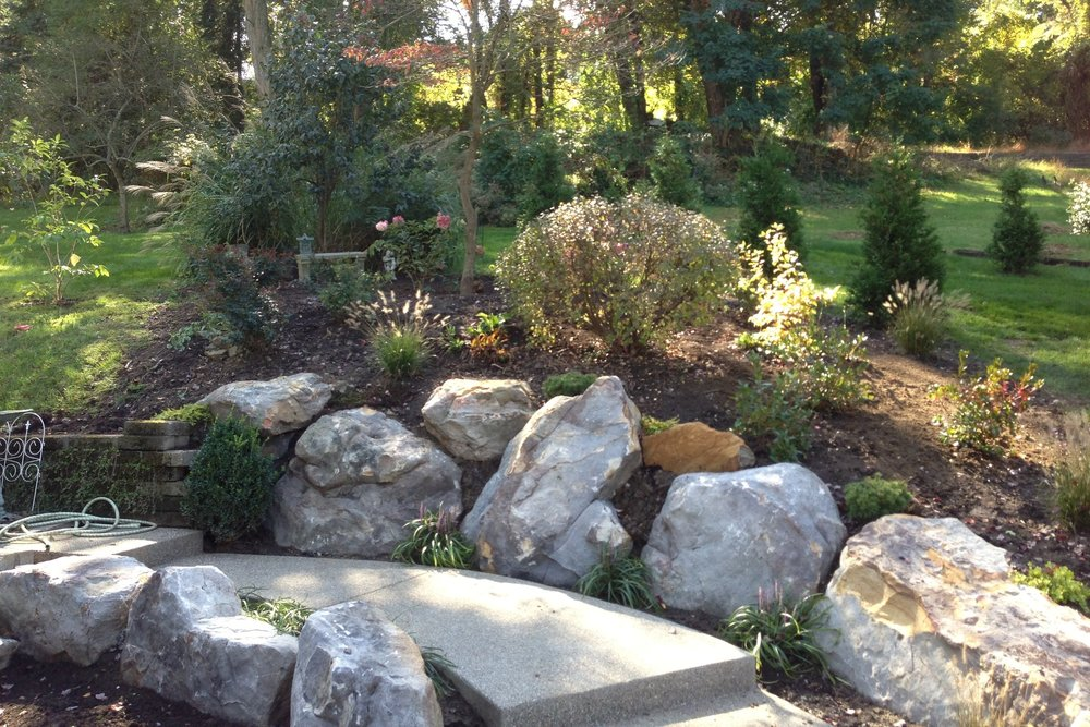 Hardscaping & Garden Elements - Hardscape refers to man made features used in landscape architecture, e.g. paths or walls, as contrasted with vegetation.