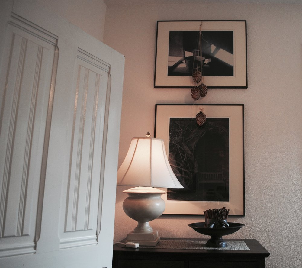 Two favorite photographs by Northwest artist Deborah DeWit hang above the chest of drawers in the main sitting room,
