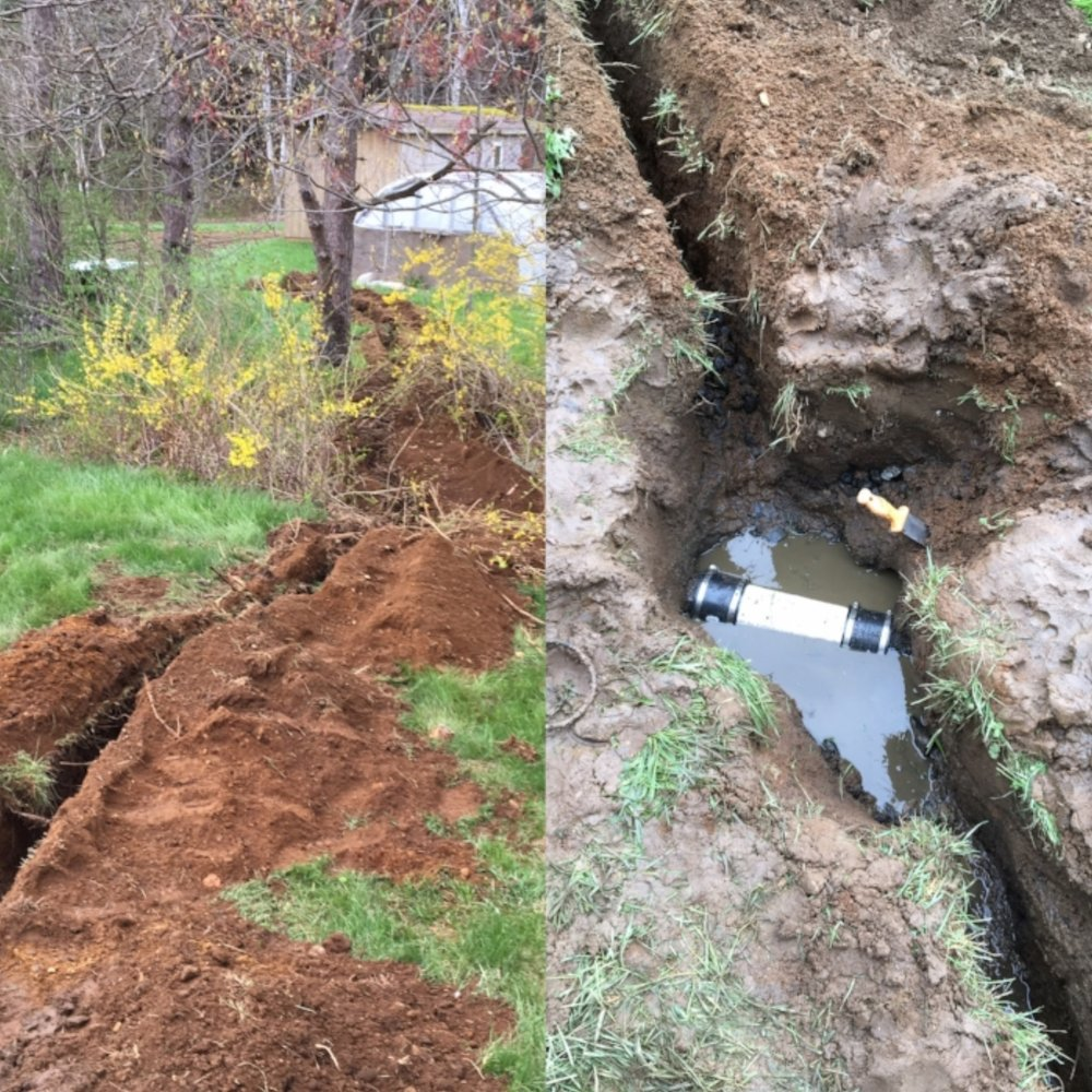 The ditch and the DIY splice job on the grey water line.