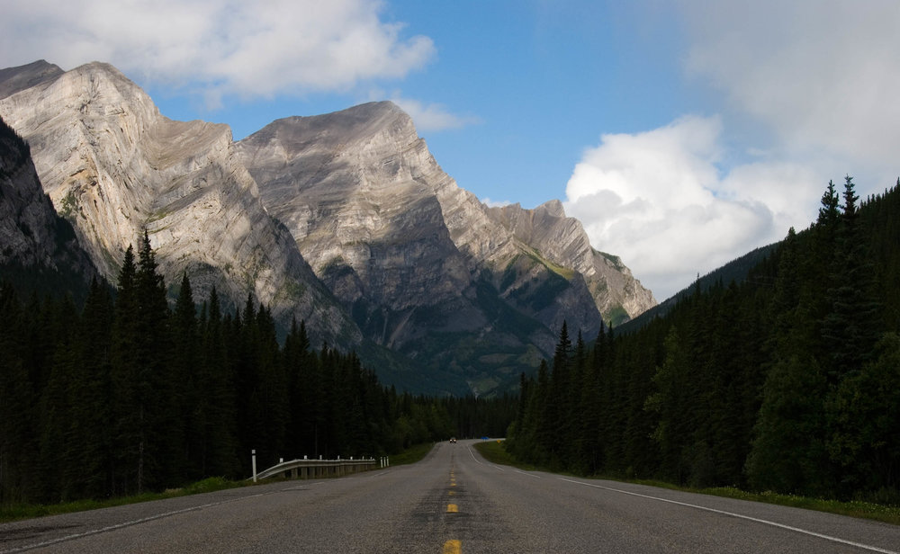 "In 2014 I had the privilege of visiting the Canadian Rockies. As a Canadian, living in Toronto, it left me wondering why I live I don't live in this part of the country (sorry Toronto!). I originally spotted this vista in the rear-view mirror of my car. I immediately pulled over and made this photograph. Since that day, my mantra while travelling has been, ""Don't forget to check the view behind you!""  This photo is of the Mt. Kidd on the Kananaskis Trail Highway just outside of Canmore, Alberta."