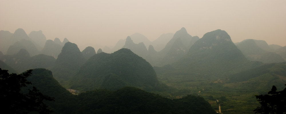 A view of the top of Moon Hill in Guangxi Region (just a few kilometres outside of Yangzhuo). The landscape of the region figured heavily in Chinese Art throughout history. It's primarily made up of these relatively small, limestone karts. It's a truly unique corner of the world!  The first of this series has been moved from the gallery to the Wind Gallery.