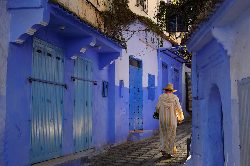 Early morning stroll, on the way to the market, in the medina of Chefchaouen - Morocco's Blue City.