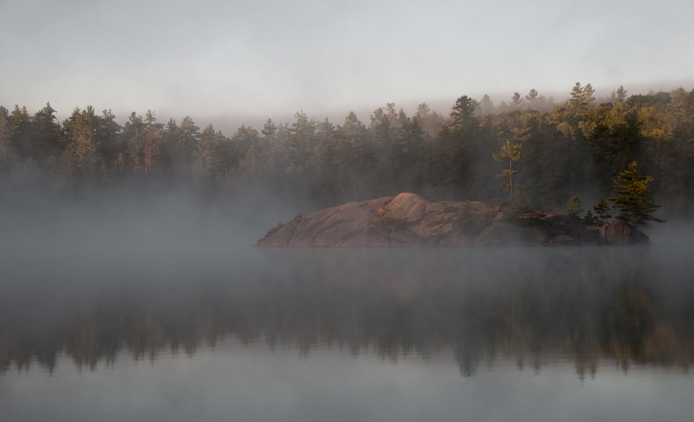 Rocky island, floating in the mist
