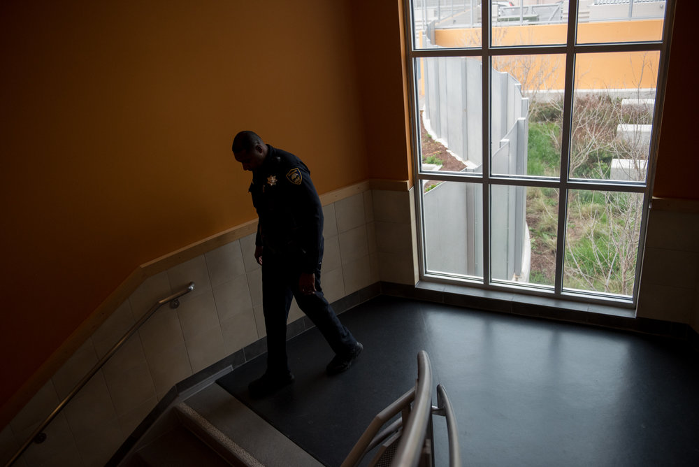 Officer Gary Lewis patrols the hallways at Sylvester Greenwood Academy on Friday, March 9 2018. | Rosa Furneaux, Special To The Chronicle