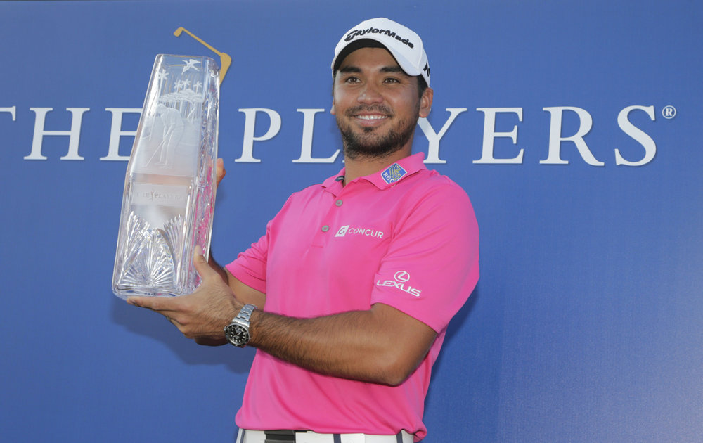 Defending champion Jason Day with the crystal.
