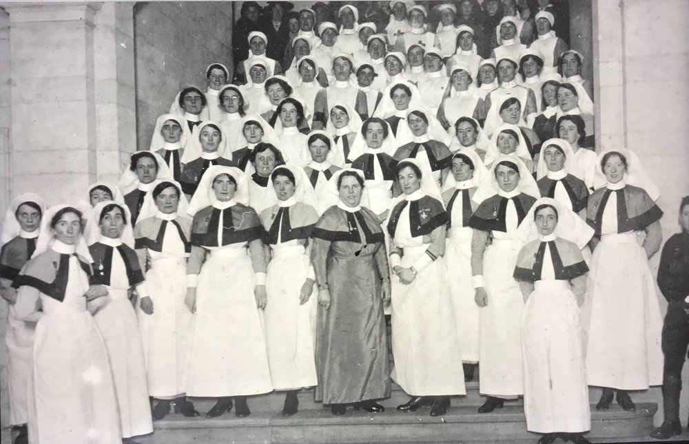 Nurses on steps of main building