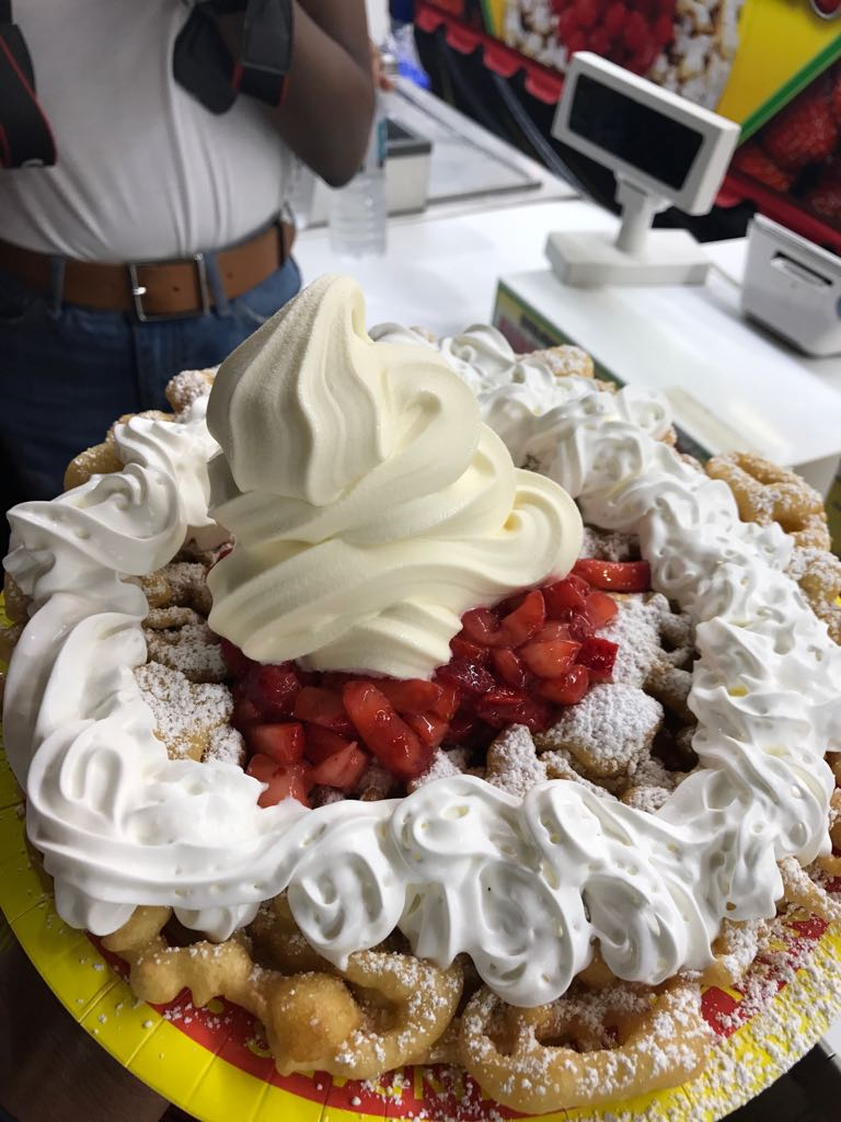 Funnel cake with cream, ice cream and strawberries