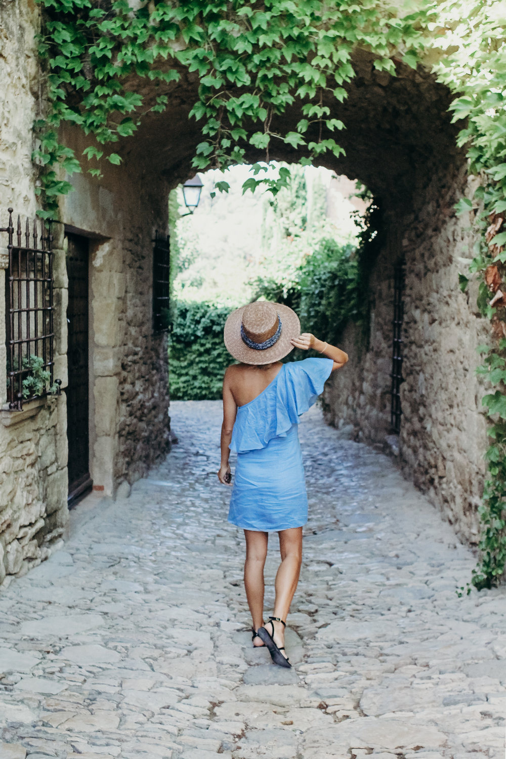 exploring Spain in capulet off the shoulder dress