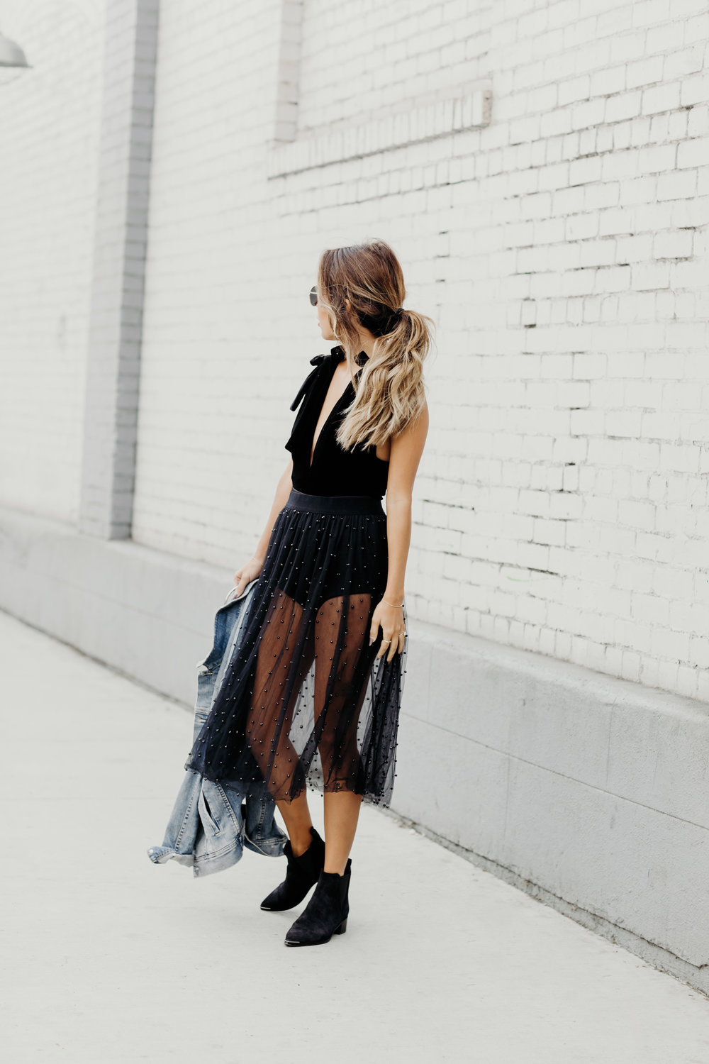edgy holiday look, how to wear sheer skirt, velvet bodysuit for holiday