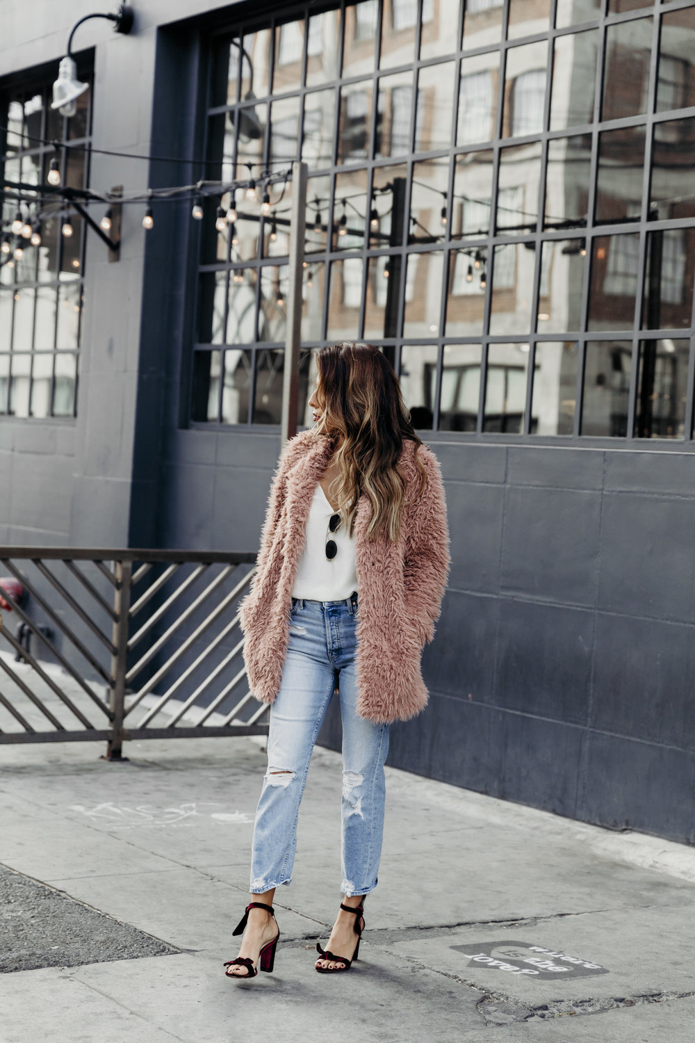 how to style jeans and heels look for winter, cozy fluffy jacket
