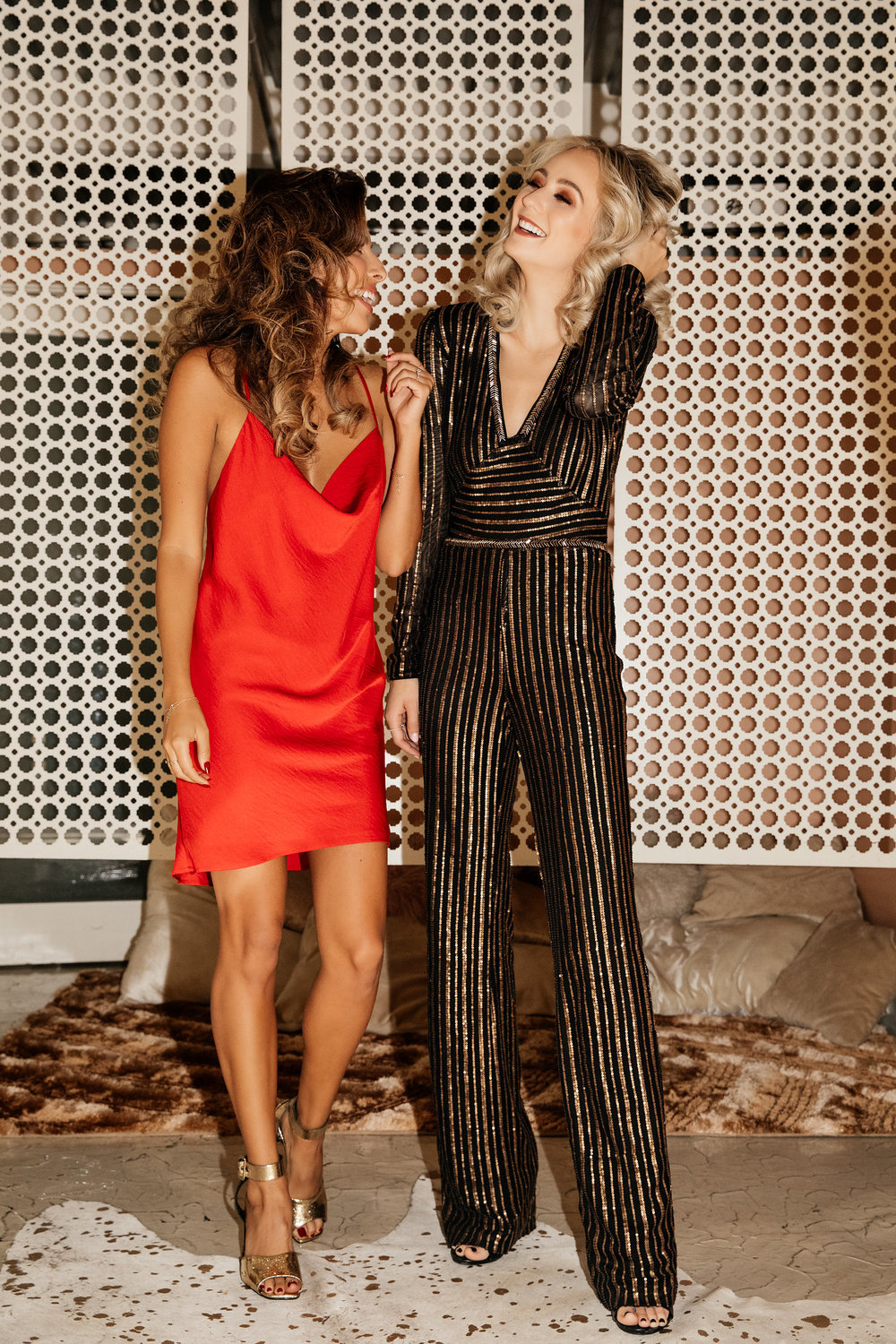 Holiday Outfits: red dress and jumpsuit ft. Ashley from Everyday Pursuits and Lauren Bushnell