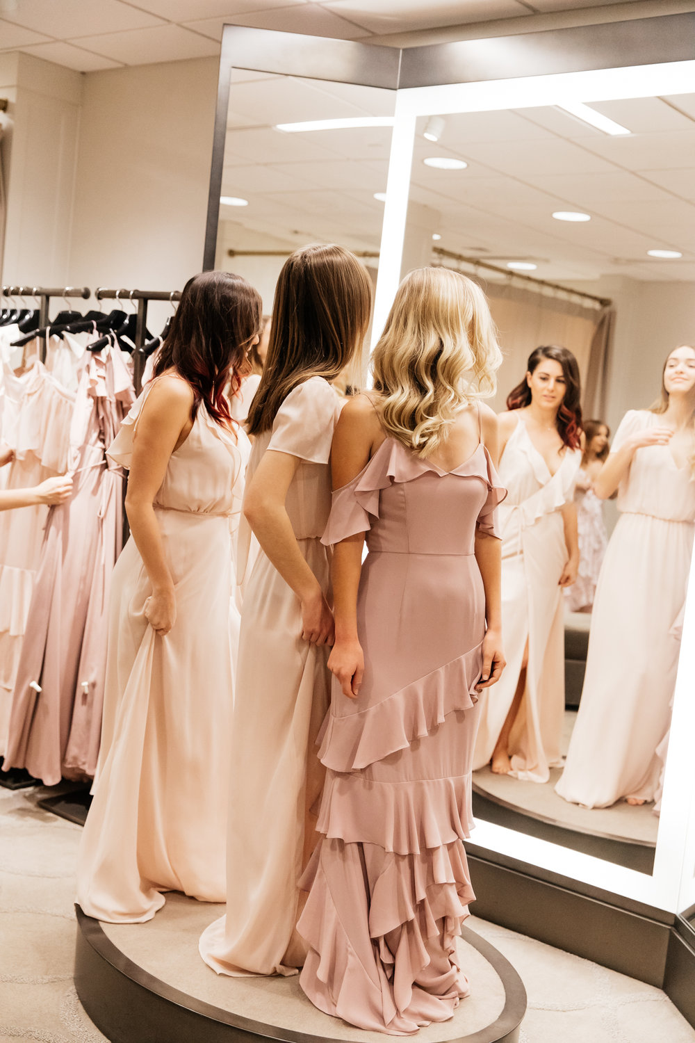 Bridesmaids finding the perfect dresses for Everyday Pursuits Wedding