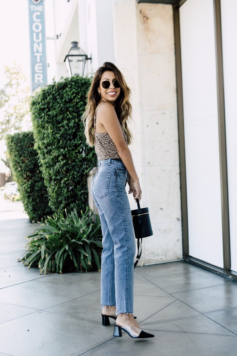 Fall outfit idea: Zara black mules and Mom jeans with leopard cami