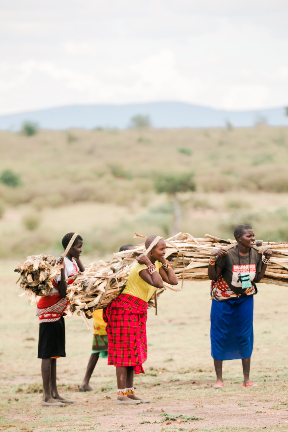 Maasai women carrying wood to local village Ph. Valorie Darling