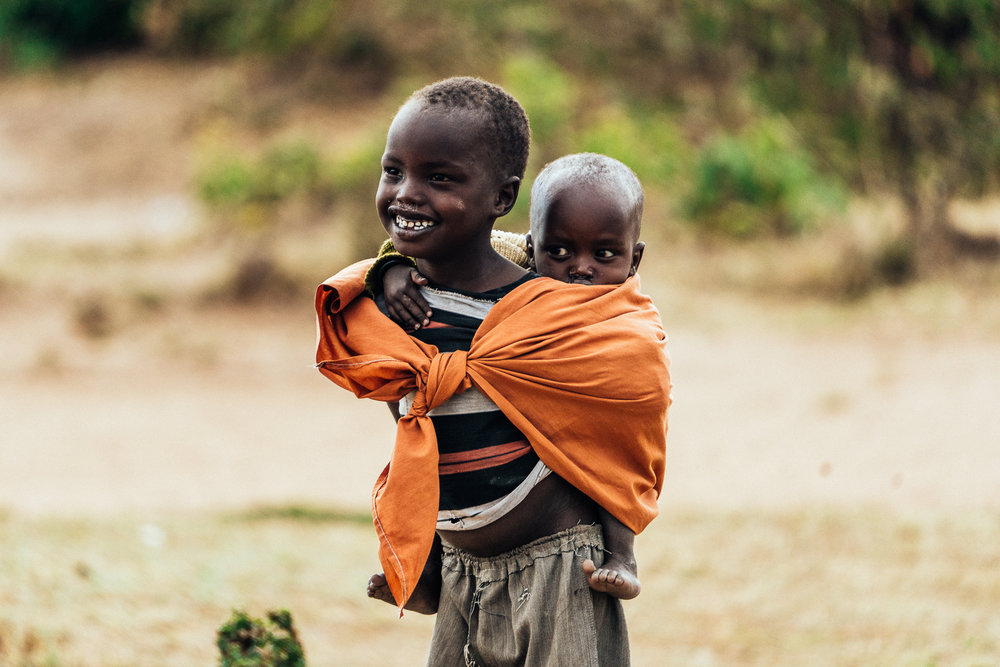 Walking through Maasai Village Ph: Dave Krugman