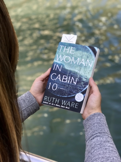 Reading The Woman in Cabin 10 by Ruth Ware on the Chicago Riverwalk