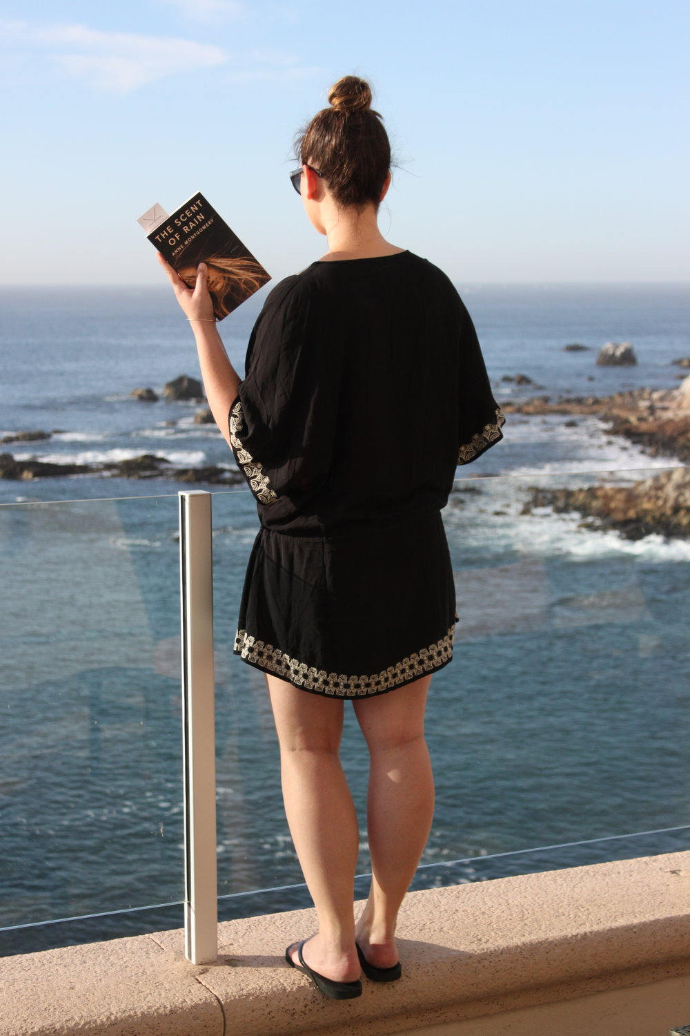 Reading The Scent of Rain by Anne Montgomery at Sirena del Mar in Cabo San Lucas, Mexico