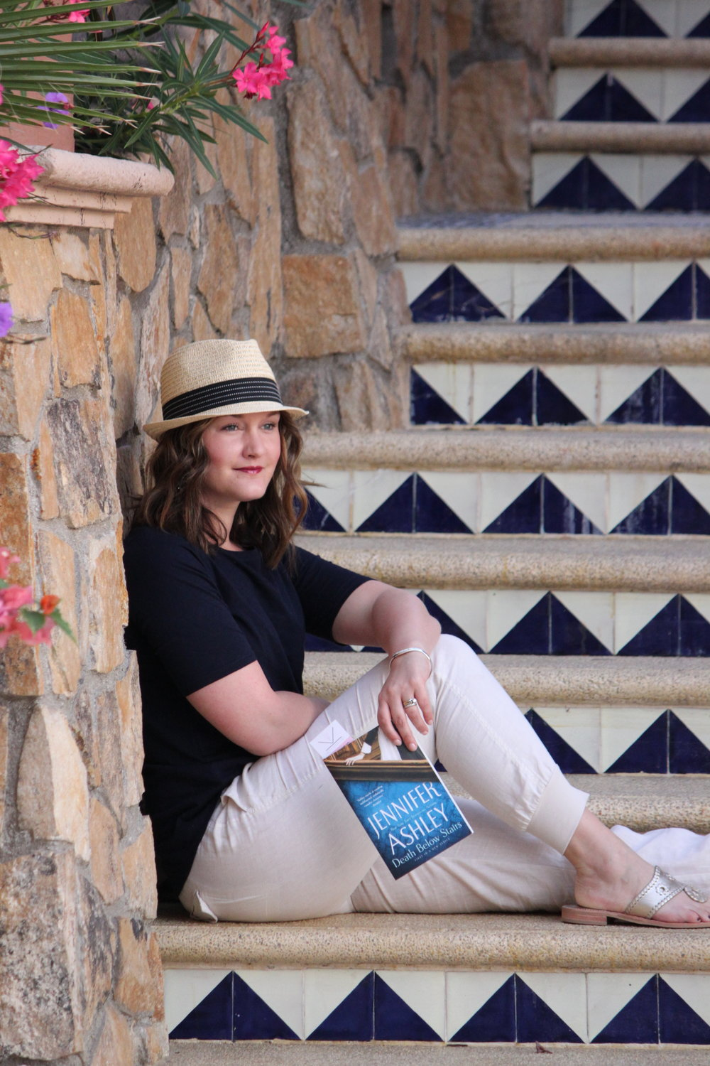 Reading Death Below Stairs by Jennifer Ashley at Sirena del Mar in Cabo San Lucas, Mexico
