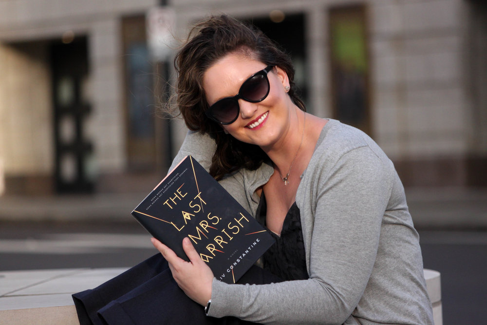 Reading The Last Mrs. Parrish by Liv Constantine outside the Fox Theatre in St. Louis, MO