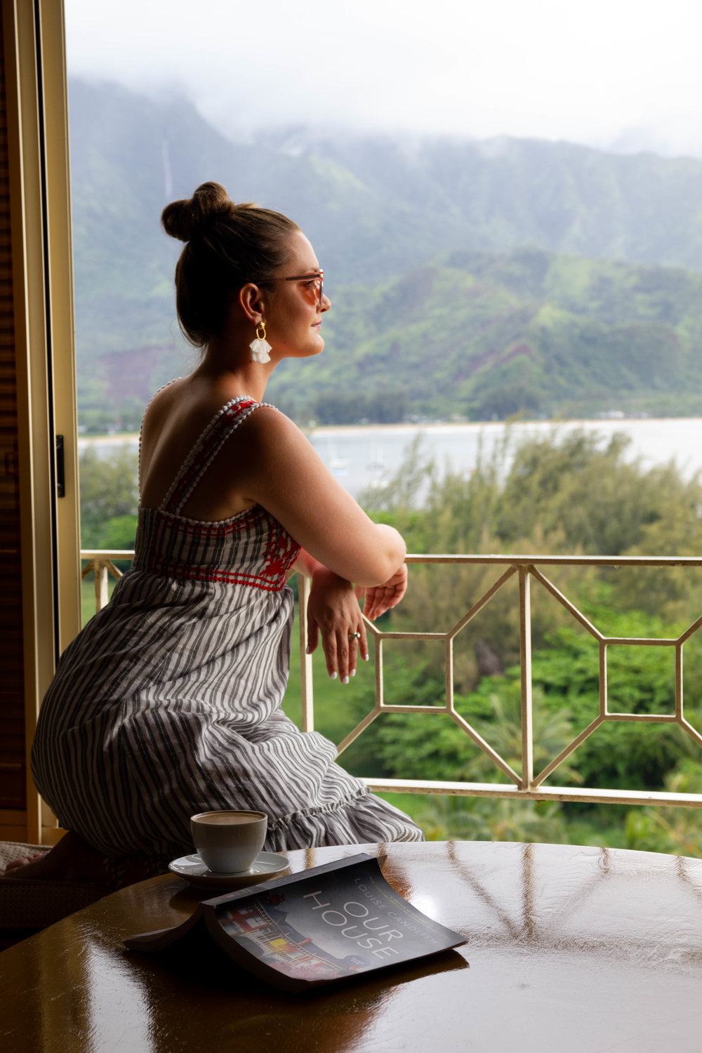 Reading Our House by Louise Candlish at the St. Regis Princeville in Kauai, Hawaii