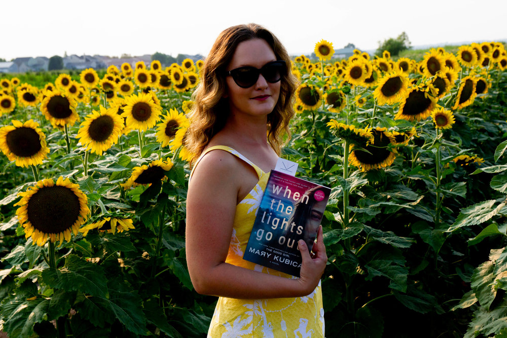 Reading When the Lights Go Out by Mary Kubica at GlenMark Farms