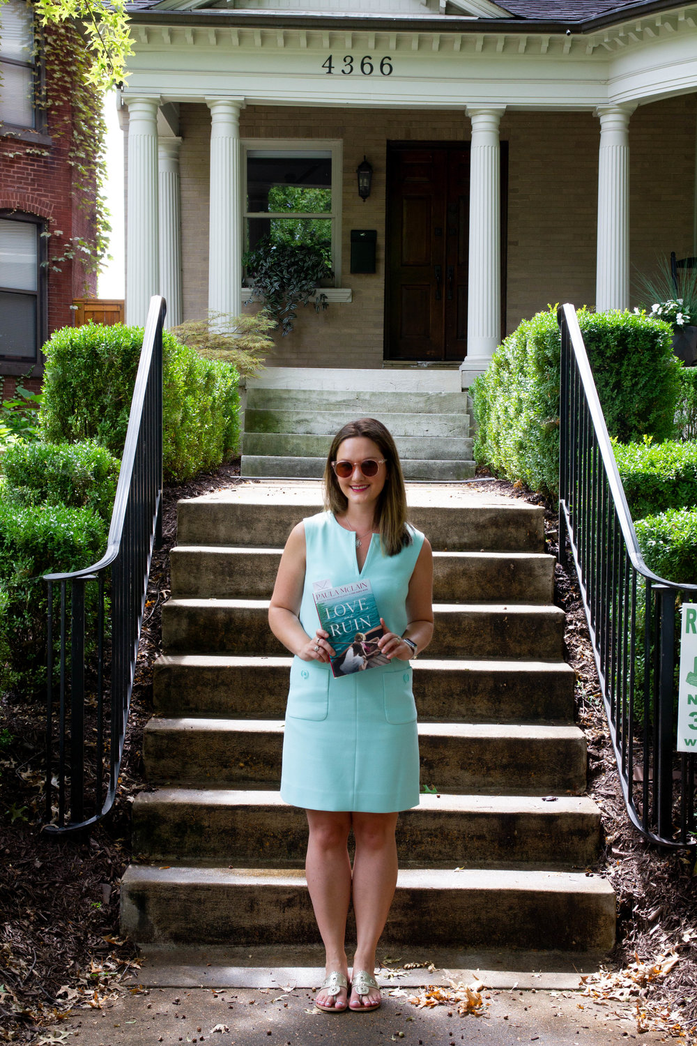 Reading Love and Ruin by Paula McLain outside Martha Gellhorn's childhood home in St. Louis