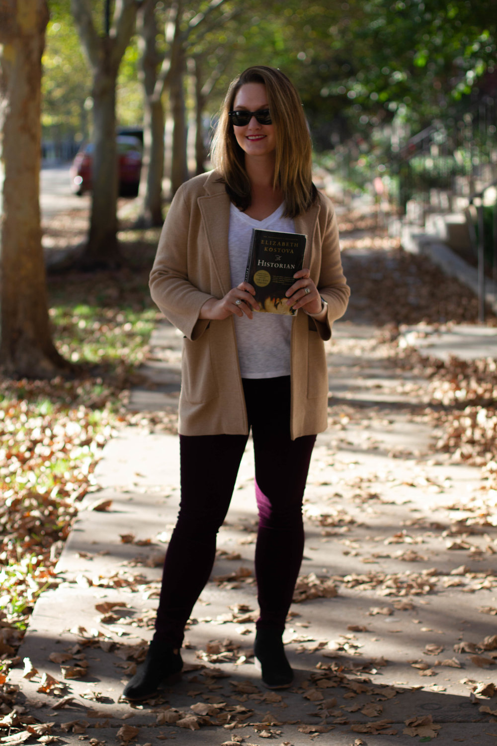 Reading The Historian by Elizabeth Kostova on the streets of New Town in St. Charles, MO