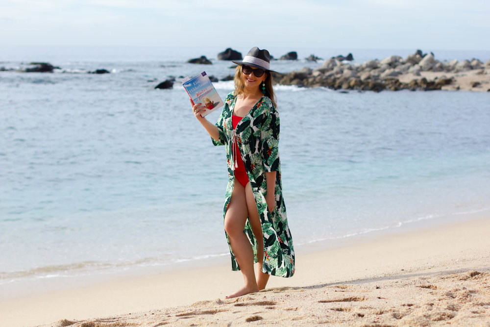 Reading Winter in Paradise by Elin Hilderbrand at Sirena del Mar in Cabo, Mexico