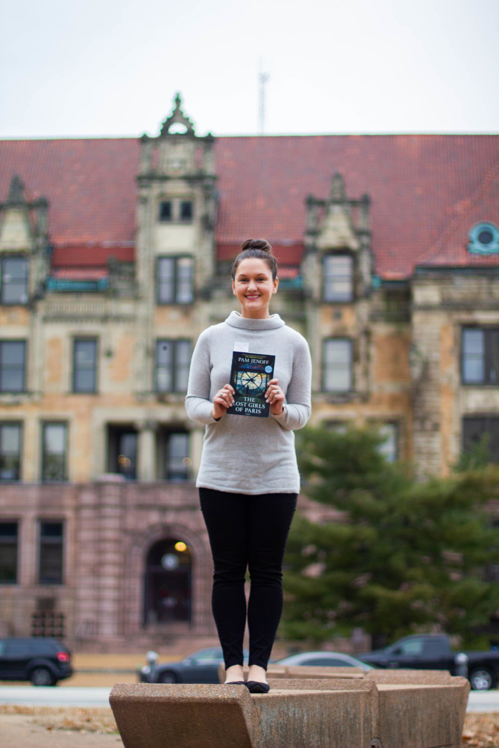 Reading The Lost Girls of Paris by Pam Jenoff at City Hall in St. Louis, MO