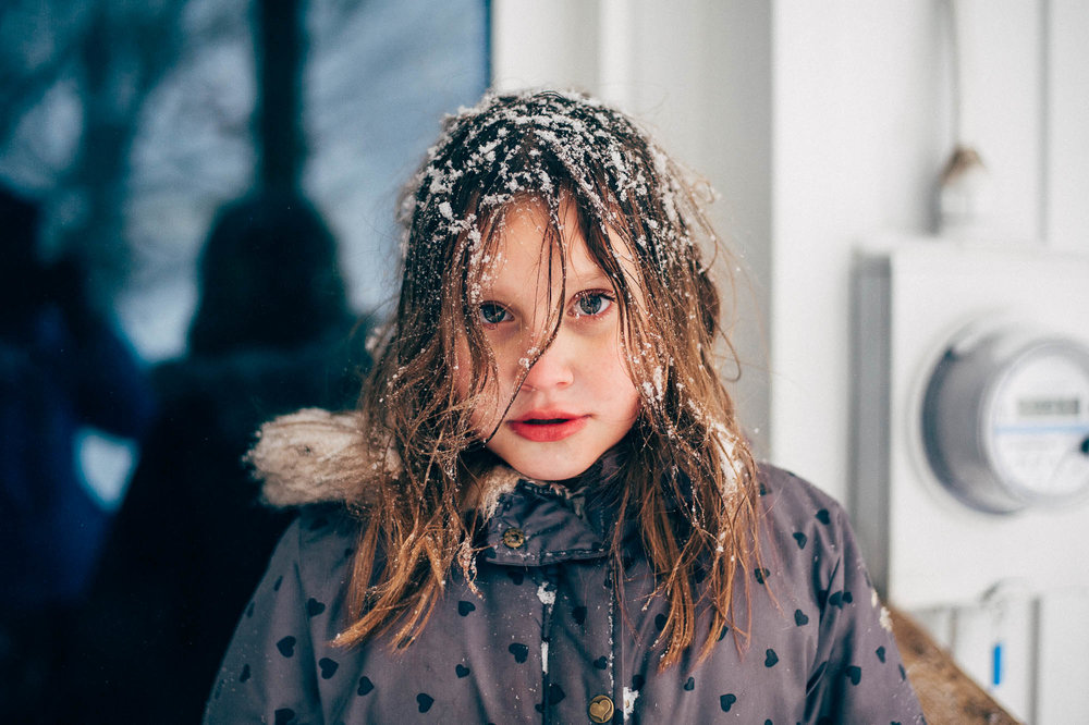 girl-with-snow-in-hair-erie-pennsylvania-family-photographer-anna-margaret-photography.jpg