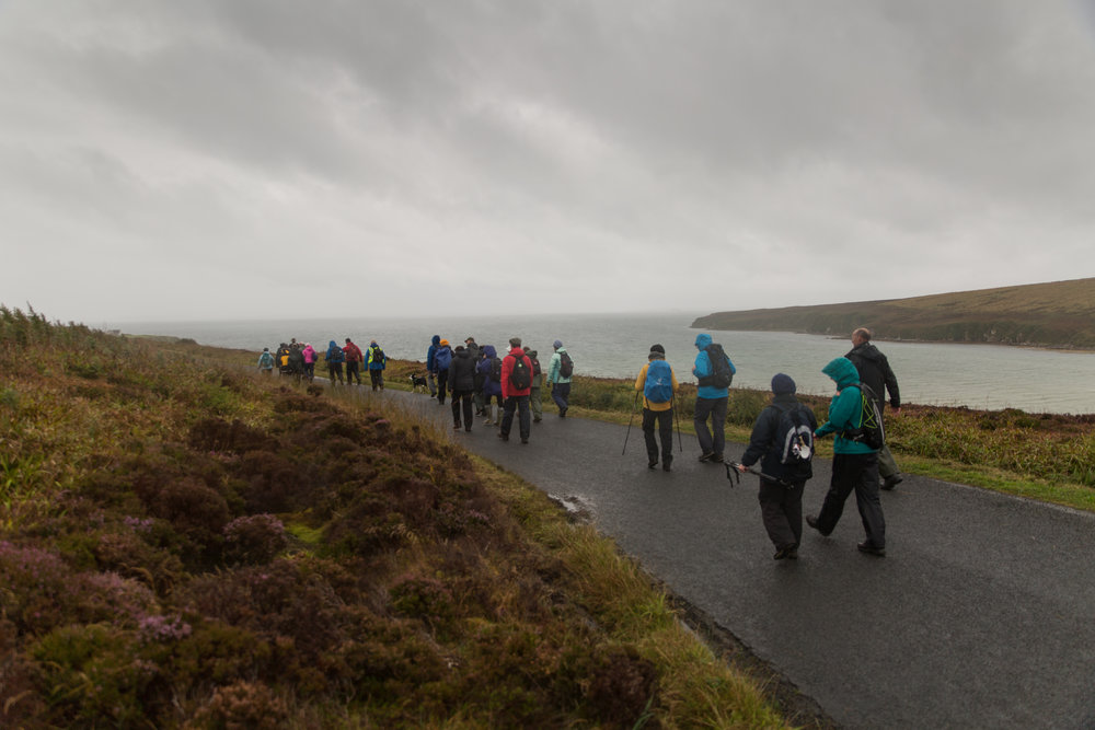 St Magnus Way walkers heading past Waulkmill bay in Orphir
