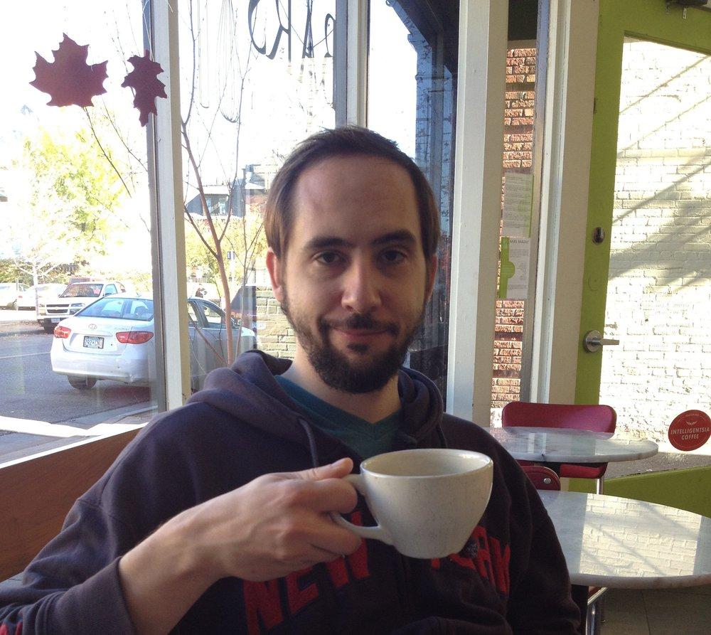 Mr. Nerd drinking local coffee